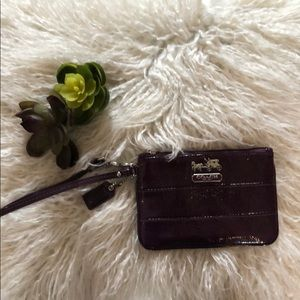 Coach wristlet plum leather with logo